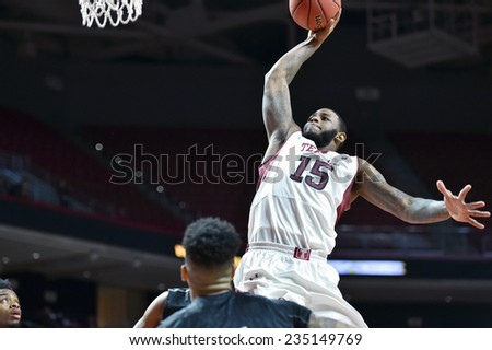 PHILADELPHIA - NOVEMBER 30: Temple Owls forward Jaylen Bond (15) goes up for dunk during the NCAA basketball game November 30, 2014 in Philadelphia. - stock photo