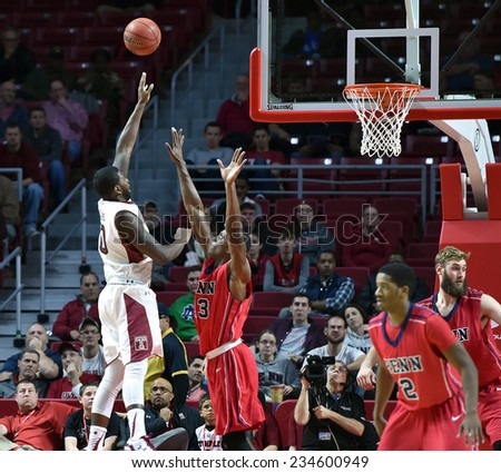 PHILADELPHIA - NOVEMBER 25: Temple Owls forward Mark Williams (10) shoots over a Penn defender during the Big 5 basketball game November 25, 2014 in Philadelphia.  - stock photo