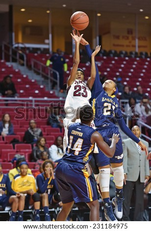 PHILADELPHIA - NOVEMBER 14:  Temple Owls guard Tyonna Williams (23) takes a contested jump shot during the season opening ladies basketball game against LaSalle November 14, 2014 in Philadelphia.  - stock photo