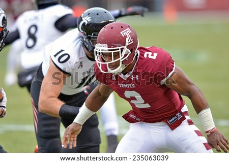 PHILADELPHIA - NOVEMBER 29: Temple Owls linebacker Avery Williams (2) prepares to tackle a ball carrier during the football game November 29, 2014 in Philadelphia.