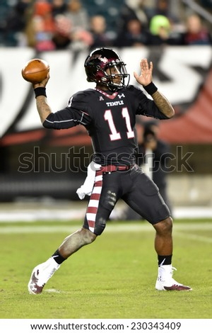 PHILADELPHIA - NOVEMBER 8: Temple Owls quarterback P.J. Walker (11) throws a pass during the AAC football game November 8, 2014 in Philadelphia, PA.  - stock photo