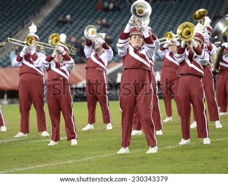 PHILADELPHIA - NOVEMBER 8: The Temple Owls Diamond Marching Band performs during the AAC football game November 8, 2014 in Philadelphia, PA.  - stock photo