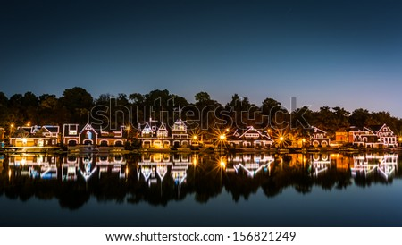 PHILADELPHIA - OCTOBER 2: Boathouse Row by night on October 2, 2013 in Philadelphia. Boathouse Row is a historic site located on the east bank of the Schuylkill River. - stock photo