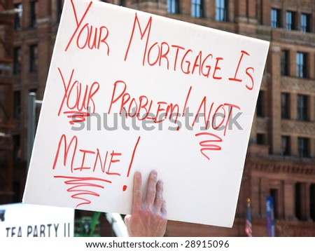 PHILADELPHIA, PA- APR 18: A protester carries a placard during tea party protest April 18, 2009 in Philadelphia. The protest is a modern-day protest to the government's spending of billions of dollars - stock photo