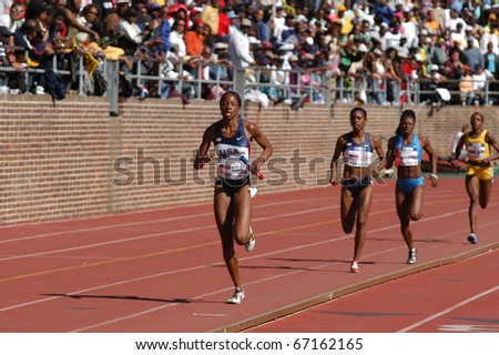 PHILADELPHIA, PA - APRIL 29: Hazel Clark runs the 800-meter anchor on April 29, 2006 in Philadelphia, she runs on USA Blue women's sprint medley on that set a world record of 3:37.16 in the 112th Penn Relays - stock photo