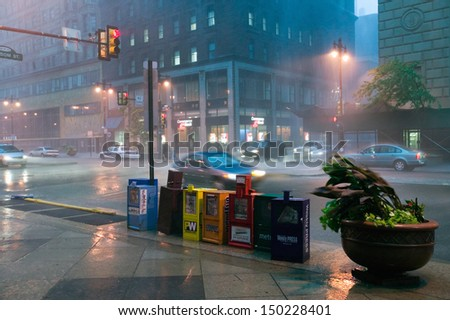 PHILADELPHIA, PA. - CIRCA 2005: Newspaper stands during rain storm in downtown Philadelphia, Pennsylvania - stock photo
