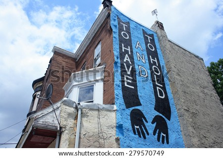 PHILADELPHIA, PA - JUNE 13: Mural painted on the wall of a building in Philadelphia, PA on June 13, 2011. - stock photo