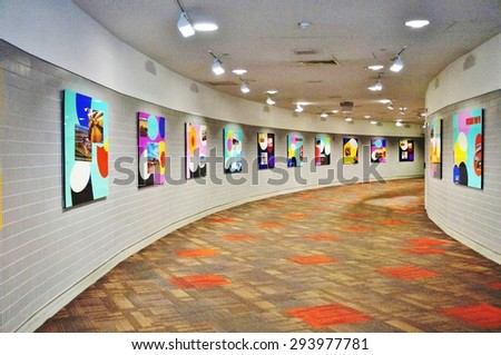 PHILADELPHIA, PA- 22 JUNE 2015- Rotating art exhibits are on display in the hallway in Terminal A at the Philadelphia International Airport (PHL). - stock photo