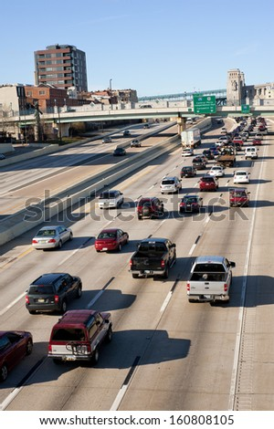 PHILADELPHIA, PA - MARCH 31: Traffic on I-95 (Delaware Expressway) in center city on March 31, 2010. I-95  is the main highway on the East Coast of the United States. - stock photo