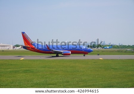 PHILADELPHIA, PA -25 MAY 2016- A Boeing 737 airplane from Southwest Airlines (WN) at the Philadelphia International Airport (PHL) with the Philly skyline in the background. - stock photo