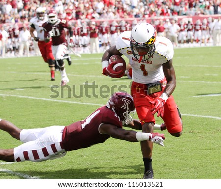 PHILADELPHIA, PA. - SEPTEMBER 8: Maryland receiver #1 Stefon Diggs makes a catch against Temple on September 8, 2012 at Lincoln Financial Field in Philadelphia, PA. - stock photo