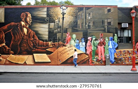 PHILADELPHIA, PA - SEPTEMBER 10: Mural painted on a wall on South Street in Philadelphia, PA on September 10, 2011. - stock photo