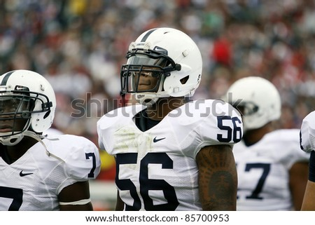 PHILADELPHIA, PA. - SEPTEMBER 17: Penn State lineman Eric Latimore rests between plays during a game against Temple on September 17, 2011 at Lincoln Financial Field in Philadelphia, PA. - stock photo