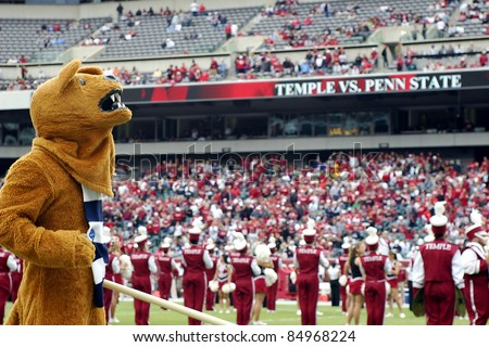 PHILADELPHIA, PA. - SEPTEMBER 17: Penn State mascot the Nittany Lion on the field during a game against Temple on September 17, 2011 at Lincoln Financial Field in Philadelphia, PA. - stock photo
