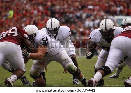 PHILADELPHIA, PA. - SEPTEMBER 17: Penn State Quarterback back Robert Bolden fumble the snap near the Goal line during a game on September 17, 2011 at Lincoln Financial Field in Philadelphia, PA. - stock photo