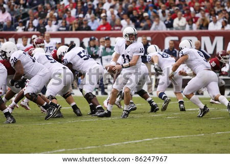 PHILADELPHIA, PA. - SEPTEMBER 17: Penn State Quarterback Matthew McGloin looks to hand off during  a game against Temple on September 17, 2011 at Lincoln Financial Field in Philadelphia, PA. - stock photo