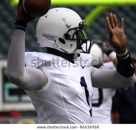PHILADELPHIA, PA. - SEPTEMBER 17: Penn State quarterback Robert Bolden warms up before a game against Temple on September 17, 2011 at Lincoln Financial Field in Philadelphia, PA. - stock photo