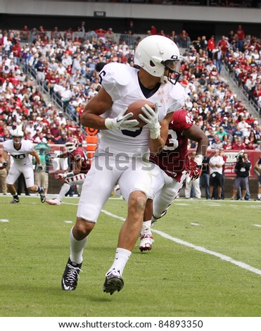 PHILADELPHIA, PA. - SEPTEMBER 17: Penn State receiver Derek Moye catches a pass and looks to run on September 17, 2011 at Lincoln Financial Field in Philadelphia, PA. - stock photo