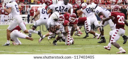 PHILADELPHIA, PA. - SEPTEMBER 17: Penn State running back Brandon Beachum (No. 3) looks for running room against Temple on September 17, 2011 at Lincoln Financial Field in Philadelphia, PA. - stock photo