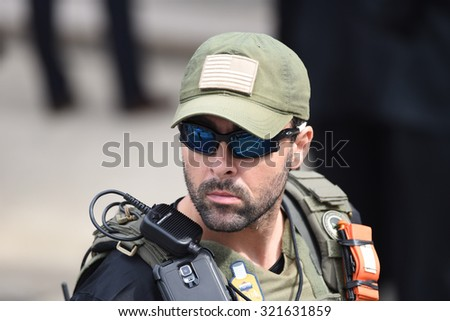 PHILADELPHIA, PA - SEPTEMBER 26 2015: Pope Francis celebrated mass at the Cathedral Basilica of Peter & Paul in downtown Philadelphia. FBI security personnel in tactical gear - stock photo