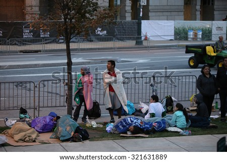 PHILADELPHIA, PA - SEPTEMBER 26 2015: Pope Francis celebrated mass at the Cathedral Basilica of Peter & Paul in downtown Philadelphia. People camping out to await view of Pope Francis - stock photo