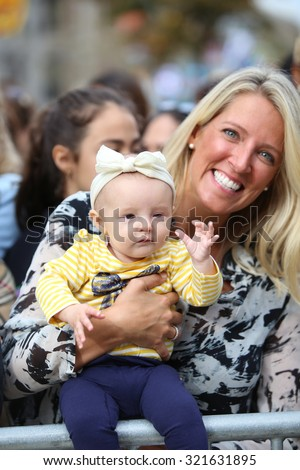 PHILADELPHIA, PA - SEPTEMBER 26 2015: Pope Francis celebrated mass at the Cathedral Basilica of Peter & Paul in downtown Philadelphia. Mother & daughter await Pope's arrival - stock photo