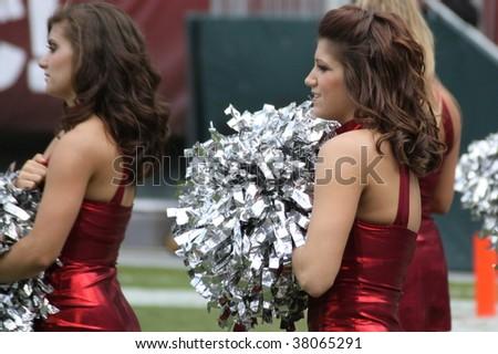 PHILADELPHIA, PA. - SEPTEMBER 26 : Temple cheerleader on the sidelines in a game against Buffalo  on September 26, 2009 in Philadelphia, PA. - stock photo