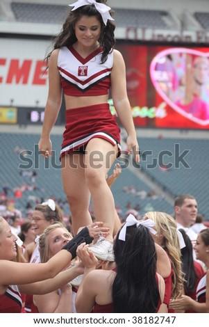 PHILADELPHIA, PA. - SEPTEMBER 26 : Temple cheerleaders on the sidelines in a game against Buffalo on September 26, 2009 in Philadelphia, PA. - stock photo