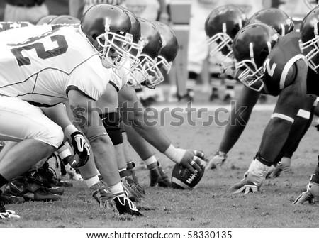 PHILADELPHIA, PA. - SEPTEMBER 26 : Temple Defensive Line face off  against Buffalo offensive linemen September 26, 2009 in Philadelphia, PA. - stock photo