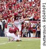 PHILADELPHIA, PA. - SEPTEMBER 17: Temple kicker Brandon McMannus kicks an extra point during a game against Penn State on September 17, 2011 at Lincoln Financial Field in Philadelphia, PA. - stock photo