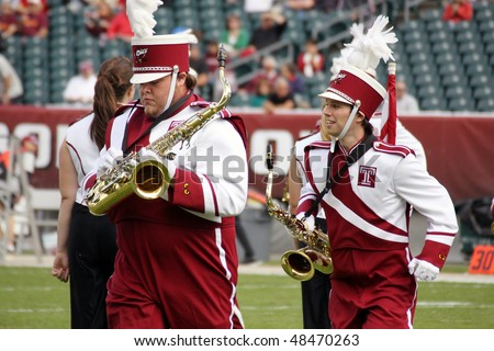 PHILADELPHIA, PA. - SEPTEMBER 26 : Temple marching band preforms during the Temple against Buffalo game on September 26, 2009 in Philadelphia, PA. - stock photo