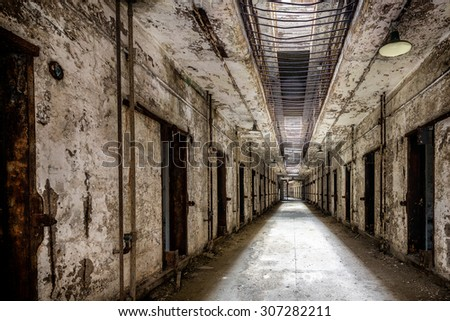 PHILADELPHIA, PENNSYLVANIA - JULY 21: Cell block in the Eastern State Penitentiary (1829) on Fairmount Avenue on July 21, 2015 in Philadelphia, Pennsylvania - stock photo