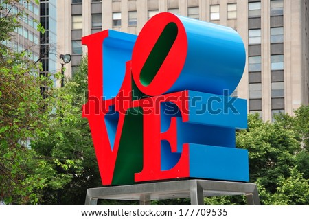 Philadelphia, Pennsylvania - June 26, 2013:  Robert Indiana's famous red, blue, and green LOVE sculpture in John F. Kennedy Plaza - stock photo