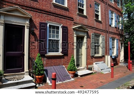 Philadelphia, Pennsylvania - June 25, 2013:  18th century colonial brick homes dating from 1703-1736 on historic Elfreth's Alley