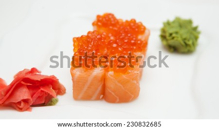 Philadelphia roll with smoked salmon and caviar, over the white background - stock photo