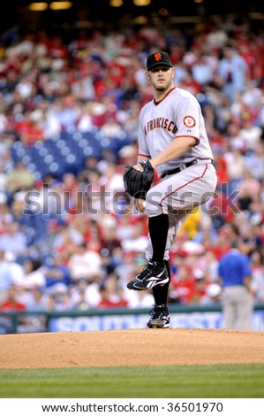 PHILADELPHIA - SEPTEMBER 2: San Francisco Giants pitcher Brad Penny delivers a pitch during the September 2, 2009 game in Philadelphia. - stock photo