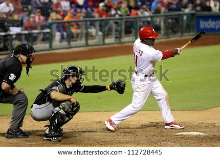 PHILADELPHIA - SEPTEMBER 10th :  Jimmy Rollins of the Philadelphia Phillies bats against the Miami Marlins on September 10th 2012 in Philadelphia - stock photo
