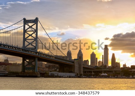 Philadelphia skyline and Ben Franklin Bridge at sunset, United States - stock photo