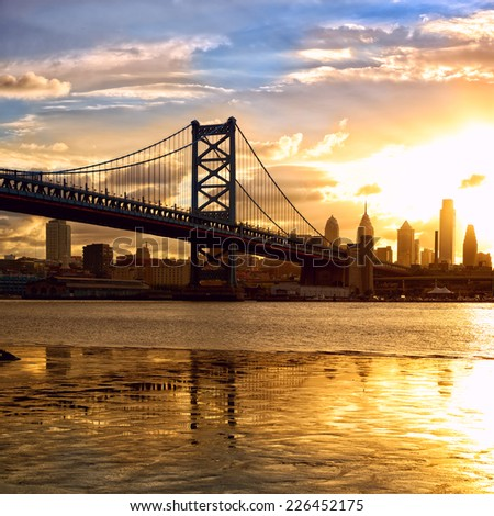 Philadelphia skyline and Ben Franklin Bridge at sunset, US - stock photo