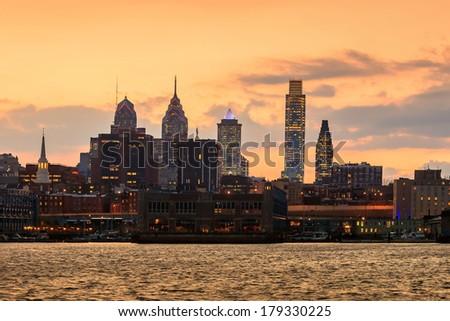 Philadelphia skyline and Penn's Landing, shown at twilight - stock photo