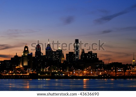 Philadelphia skyline and Penn's Landing, shown at twilight - stock photo
