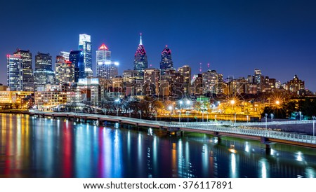 Philadelphia skyline by night reflected in Schuylkill river - stock photo