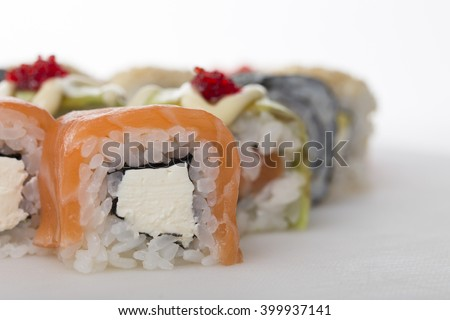 Philadelphia sushi roll with cream cheese. Macro. Photo can be used as a whole background. - stock photo