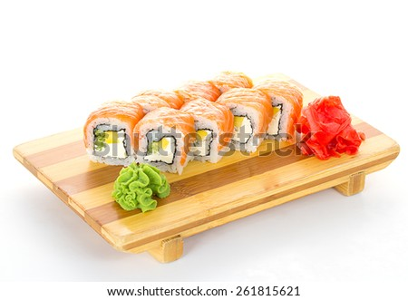 Philadelphia sushi roll with ginger and wasabi on gete isolated - stock photo