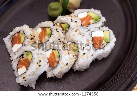 Philadelphia sushi roll with wasabi and pickled ginger - stock photo