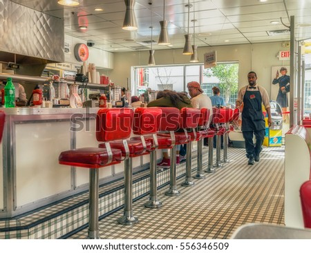PHILADELPHIA, USA - AUGUST 2, 2016:Interior of local cafe in Philadelphia - the largest city in the Commonwealth of Pennsylvania and the fifth-most populous city in the USA.  Vivid, splittoned image.