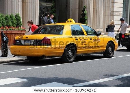 PHILADELPHIA, USA - JUNE 11, 2013: Unidentified person exits taxi cab in Philadelphia. As of 2012 Philadelphia is the 5th most populous city in the US with 1,547,607 citizens. - stock photo