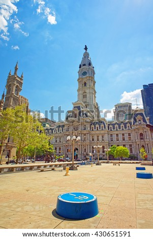 Philadelphia, USA - May 4, 2015: Square near Philadelphia City Hall. Philadelphia City Hall and Church on the background. Pennsylvania, USA. - stock photo