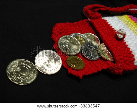 Philippine coins on knitted pouch