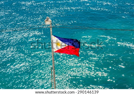 Philippines Flag on Pole Over aqua ocean - stock photo